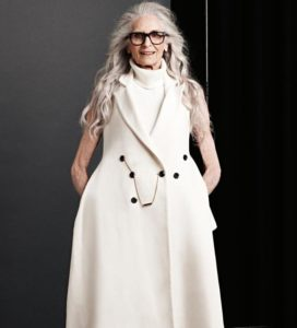 6. Long hairstyles for 60 year old woman with glasses
