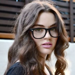 9. Long hairstyles for 60 year old woman with glasses